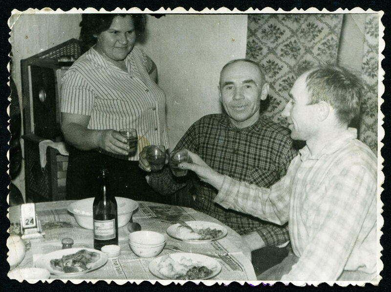 In this photo from around 1970, a woman and two men drink vodka.