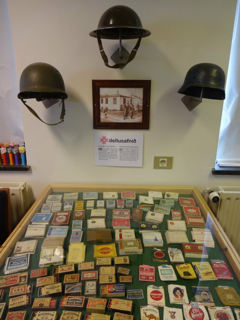 Tobacco packaging, matchbooks, Pez dispensers, and helmets at the Nonsense Museum in Flateyri.