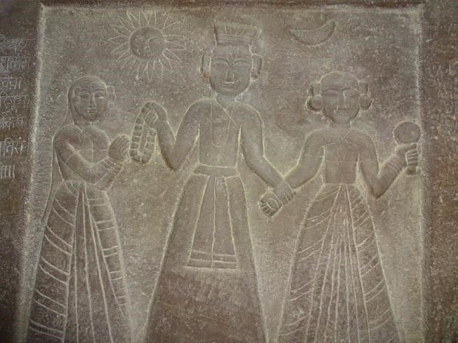 A sati stone depicting a king and his two wives at Orchha, Madhya Pradesh.
