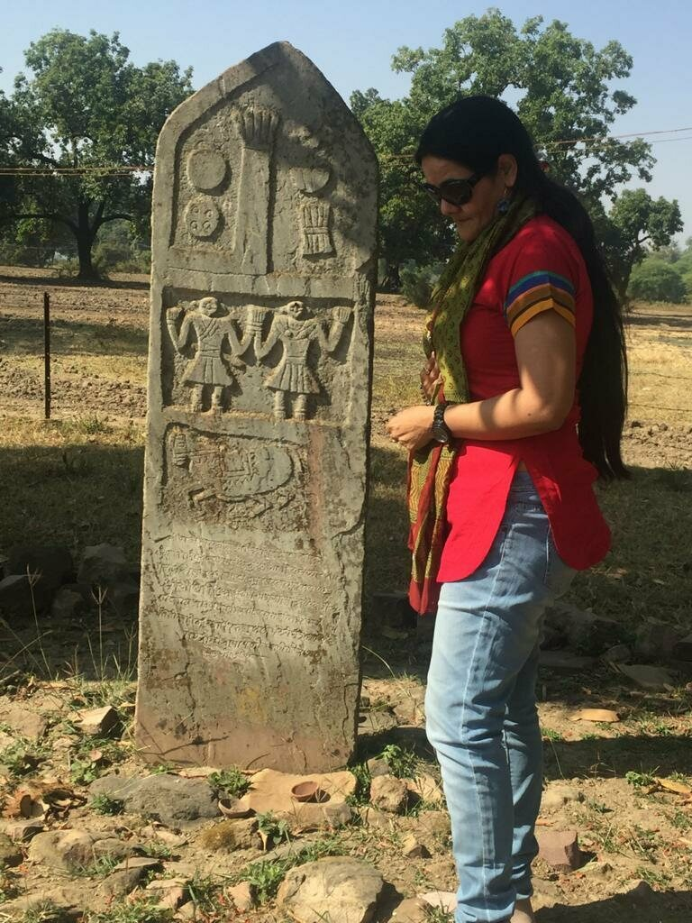 Ameeta Singh with one of the sculpted sati stones that she seeks out and documents.