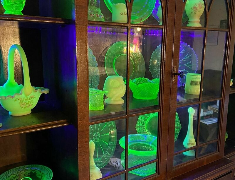 Dan and Lisa Sawyer's cabinet of uranium glass.