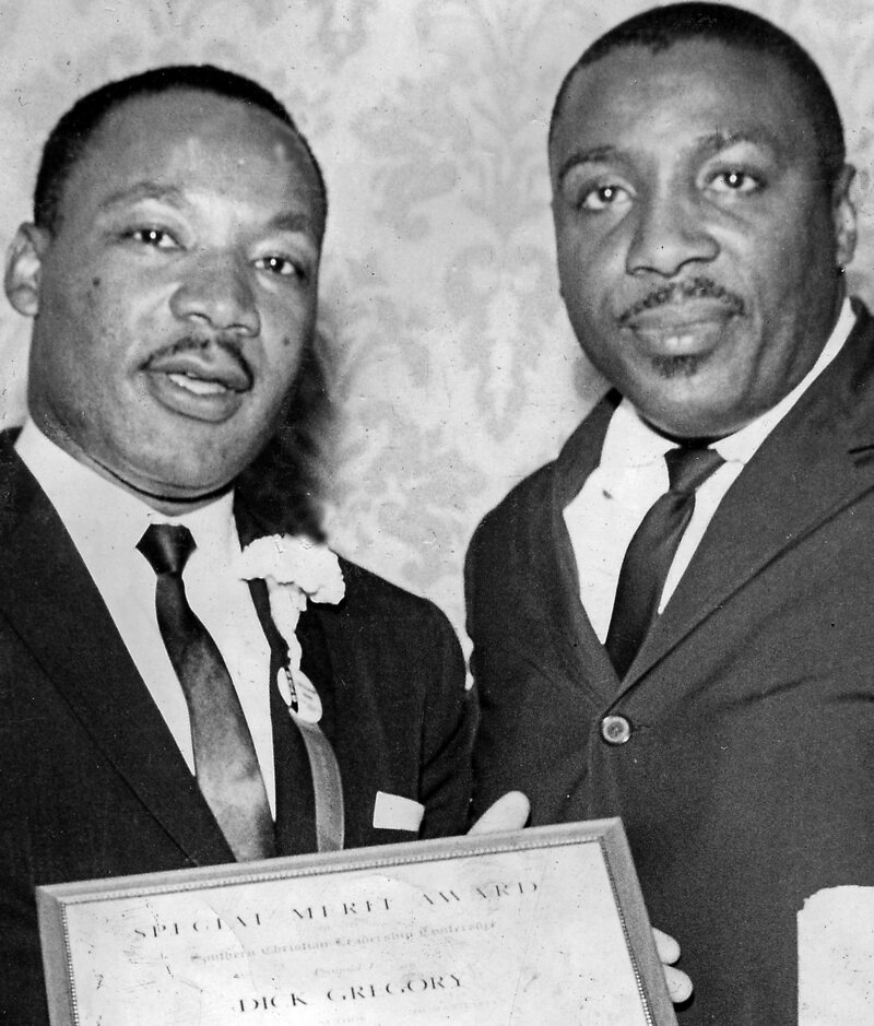 Gregory with Dr. Martin Luther King Jr. after the comedian won the Merit Award of the Southern Christian Leadership Conference in 1963.