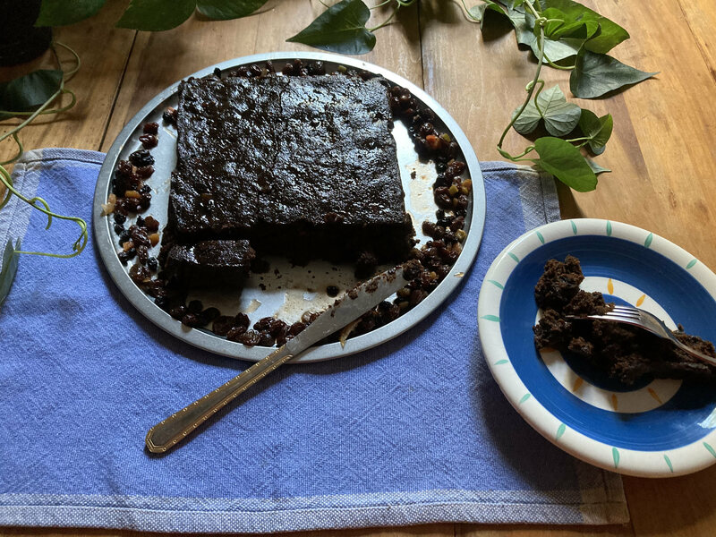 Emily Dickinson's version of the cake uses brandy and molasses rather than rum and browning.