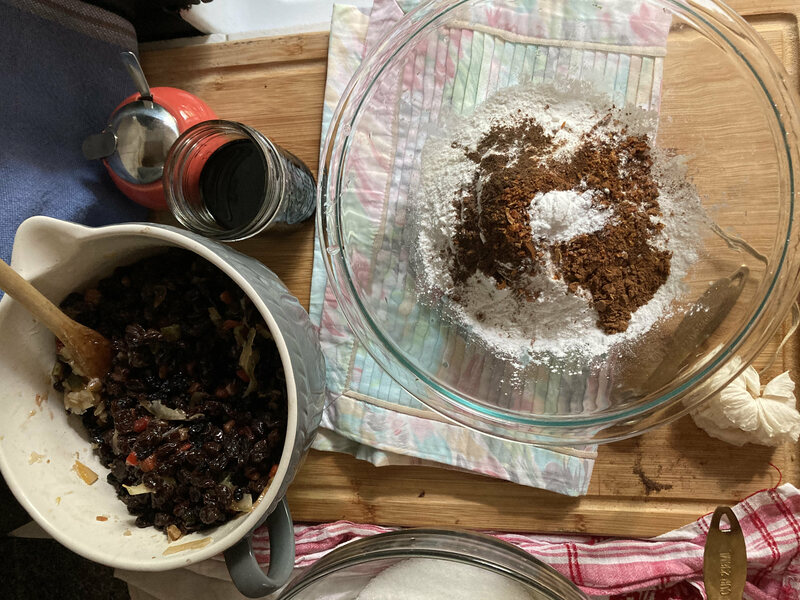 Mixing wet and dry ingredients for the cake.