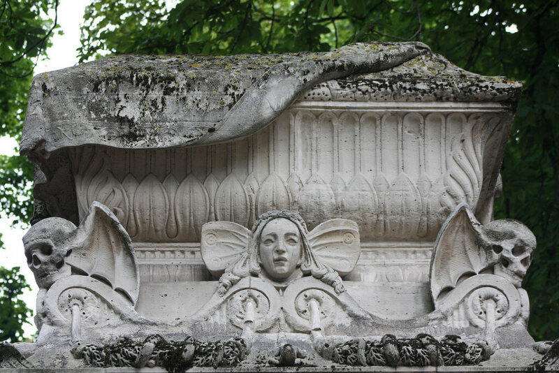 Bat tomb symbol in Pere Lachaise Cemetery in Paris