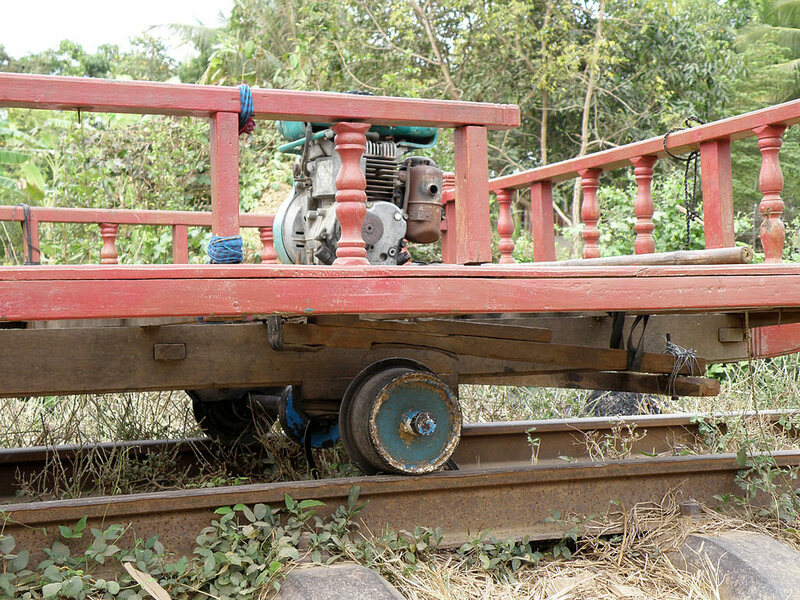 Old tractor engine rigged to power a Norry train