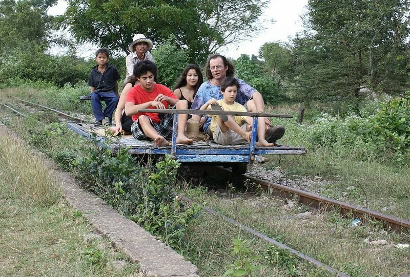 Tourists on a norry train in Battambang, Cambodia