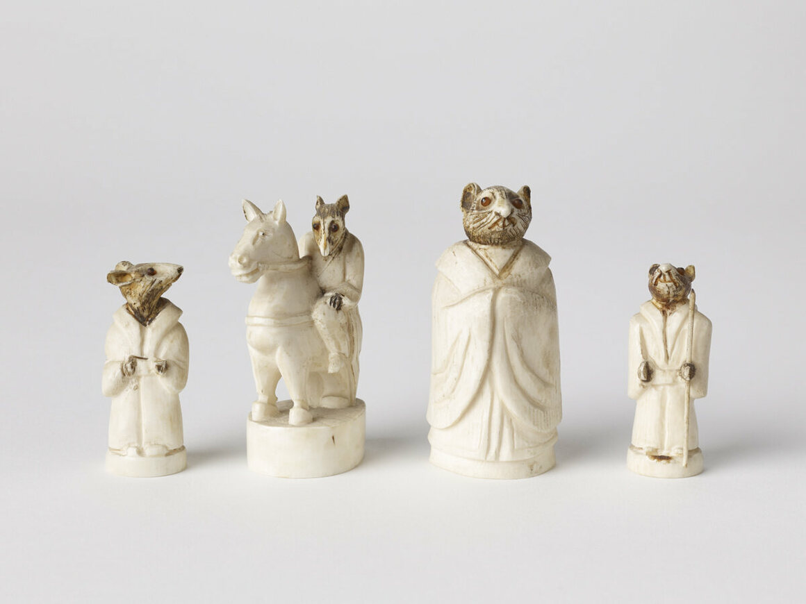 A Chinese chess set from the early 18th century. The pieces are depicted as rats, the first animal in the Chinese zodiac. Carved from ivory, the eyes are pieces of ruby and amber.