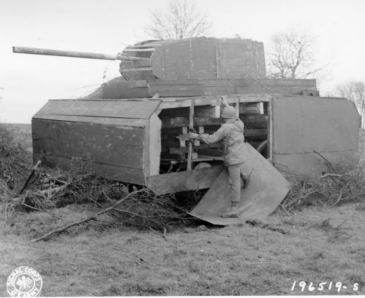 An American soldier looks at one of the German dummy tanks near Metz, France.