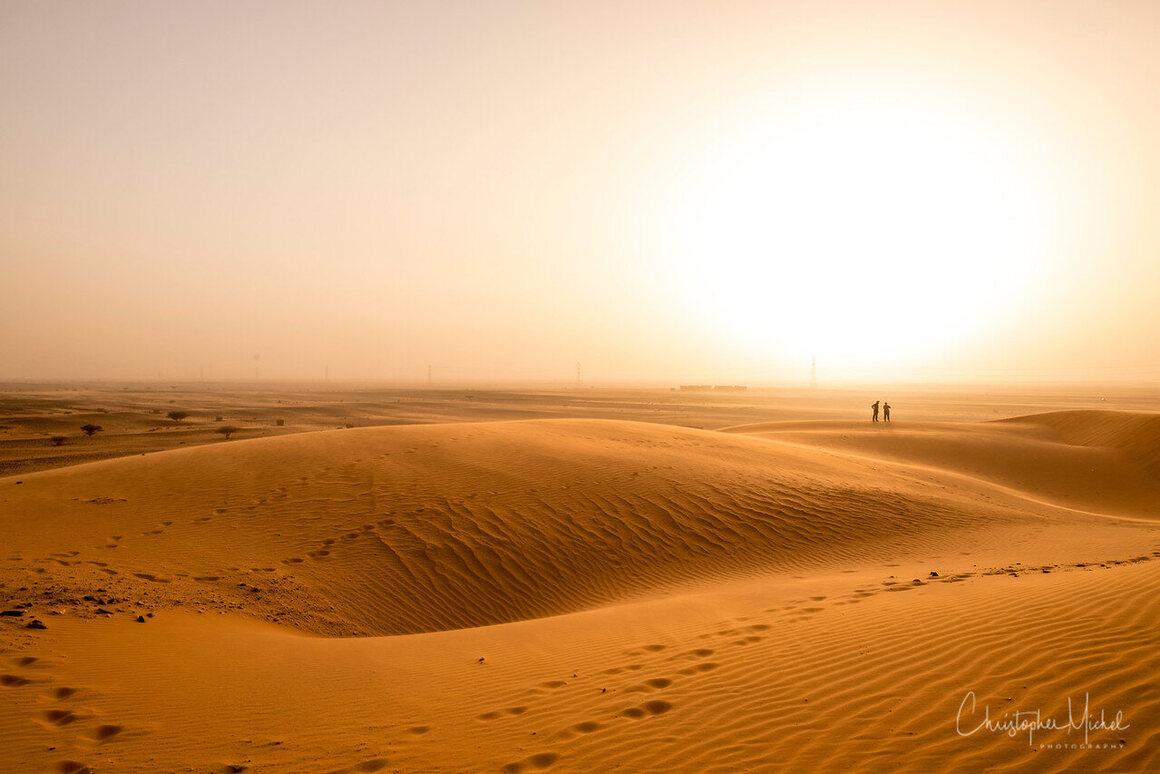 Red sandstorms blend sky and land.