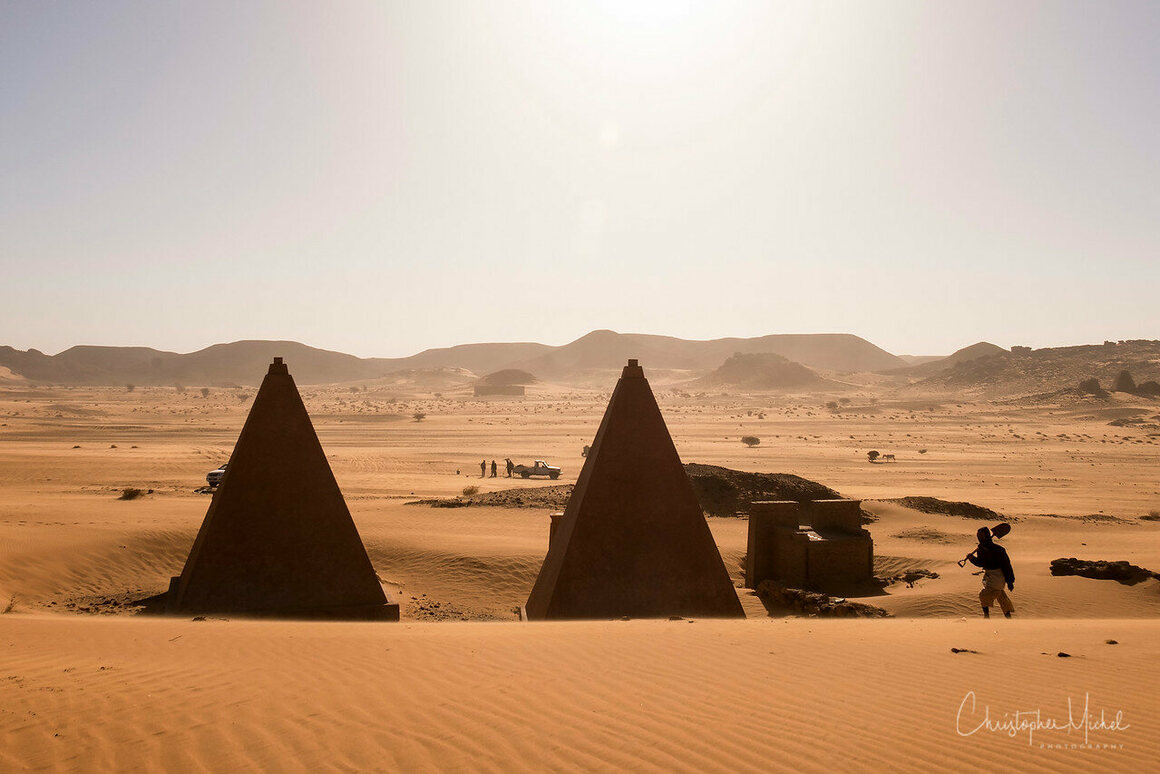 Workers are constantly digging sand from around the pyramids to keep the desert at bay.