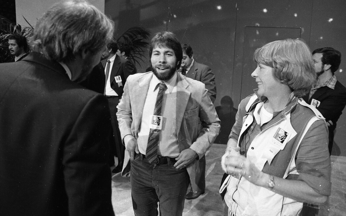 "April 23, 1984: Steve Wozniak works the crowd after the Apple IIc was introduced at the ""Apple II Forever"" event at Moscone Center in San Francisco."