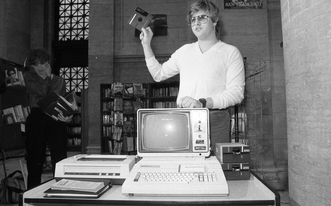 January 8, 1983: The first computer at the San Francisco Public Library was coin-operated and cost $1 for 20 minutes. With the computer is the mastermind behind the project, 18-year-old Salinas resident Kim Cohan.
