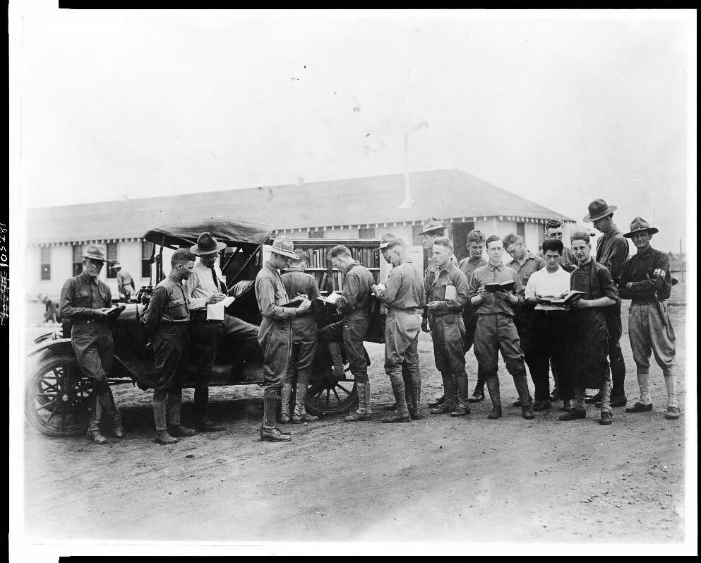 Soldiers getting library books from a truck, Kelly Field Library, Texas, c. 1917.