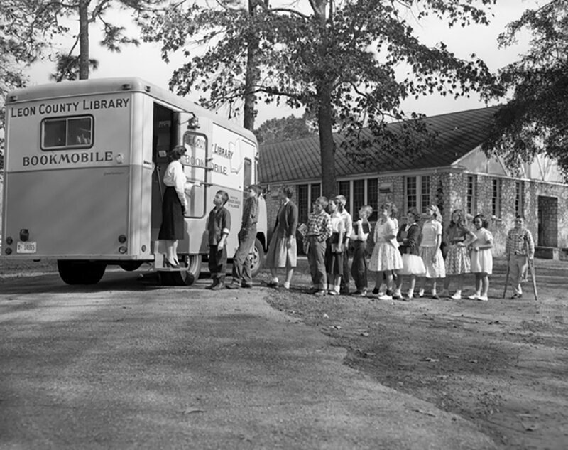 Students lining up at the Leon County Public Library bookmobile, Woodville Elementary School, Florida, 1957.
