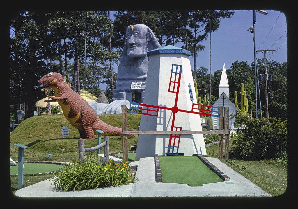 <em>Windmill and dinosaur view 1, Wacky Golf</em>, South Carolina, 1979.