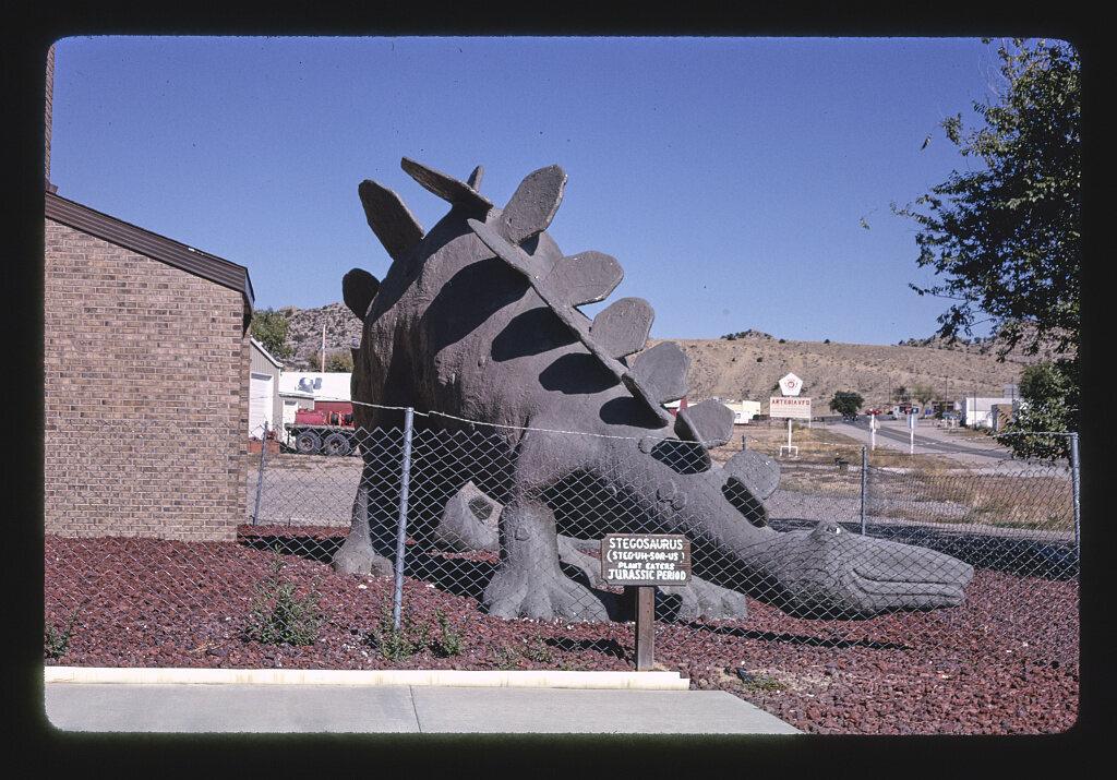 <em>Stegosaurus statue at town hall, view 2, Route 64</em>, Colorado, 1991.