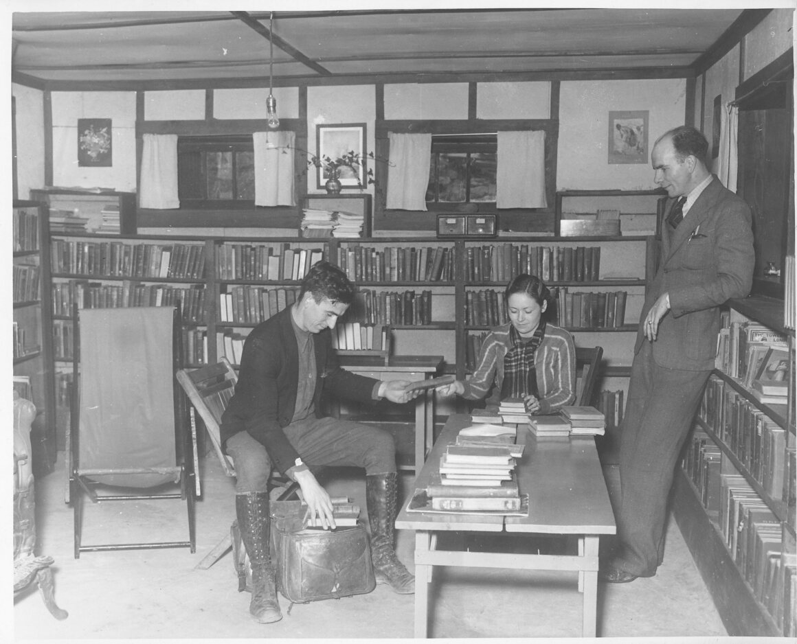 Packing saddle bags with books, date unknown.