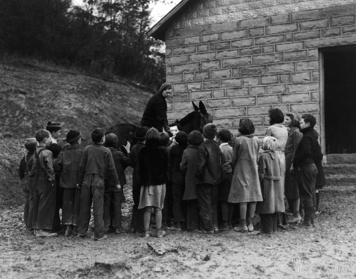 "Children greet the ""book woman,"" 1940."