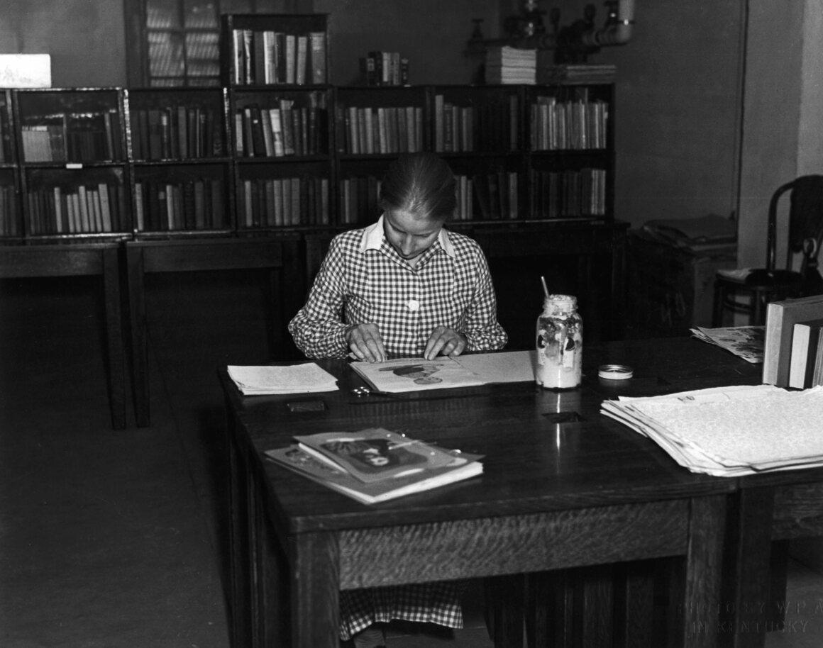 Making a scrapbook, c. 1940.