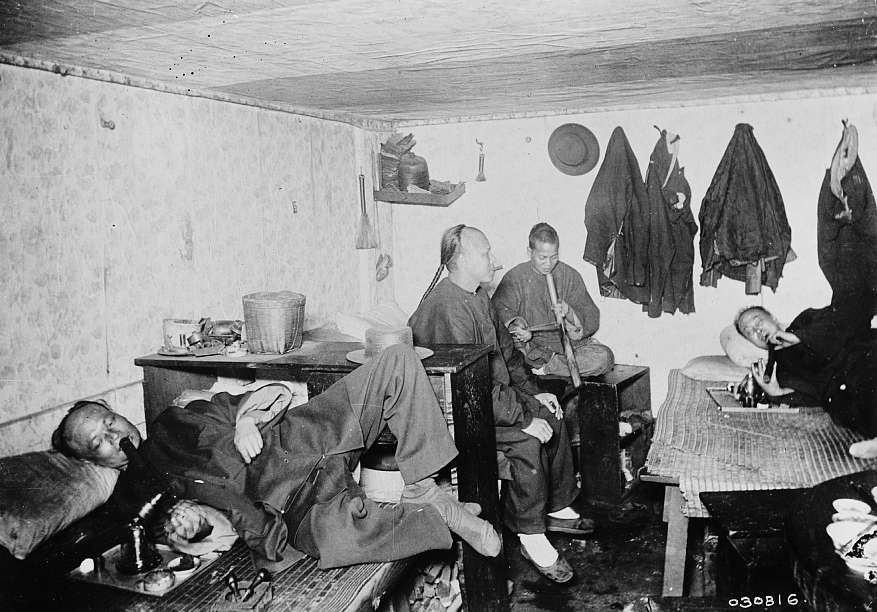Real opium dens like this one, photographed some time between 1890 and 1910, loomed large in the popular imagination.