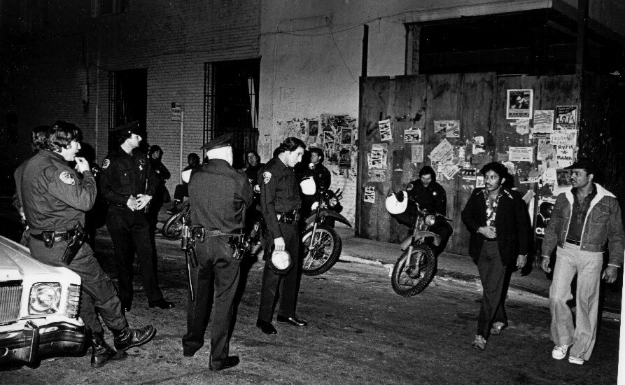 Police presence was always a feature of the celebrations, whether benevolent or confrontational, as seen here on Halloween 1980 on Polk Street.