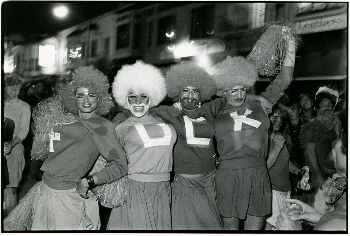 Four men dressed as cheerleaders in the Castro for Halloween 1982.
