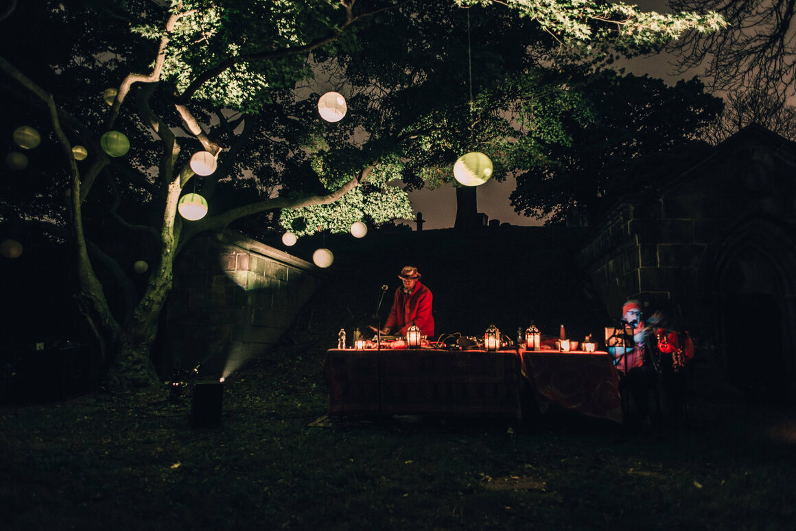 Musician Laraaji, accompanied by Arji OceAnanda, played his dulcimer under a tree studded with lanterns.