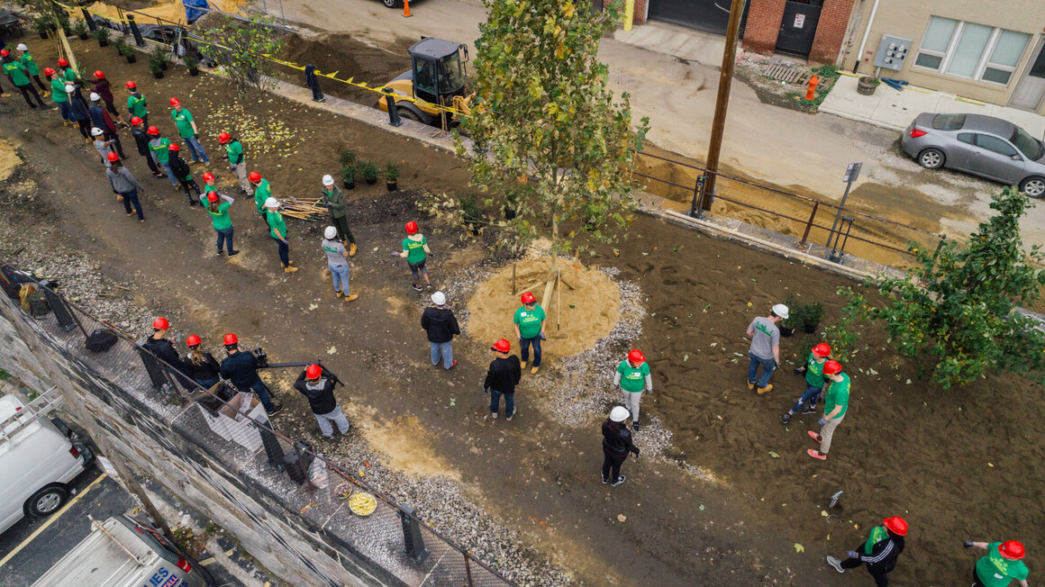 Volunteers gather to help transform the Rail Park into an urban green space.