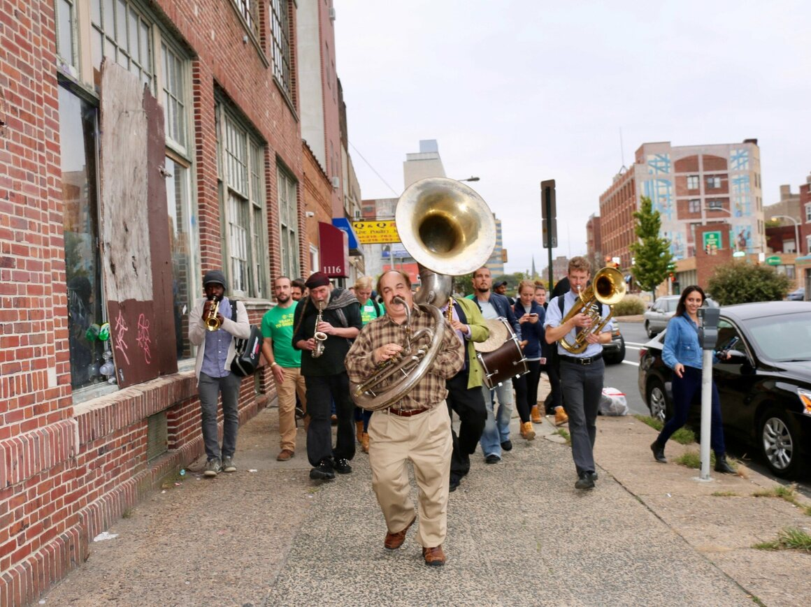 The West Philadelphia orchestra leads volunteers to the after party.
