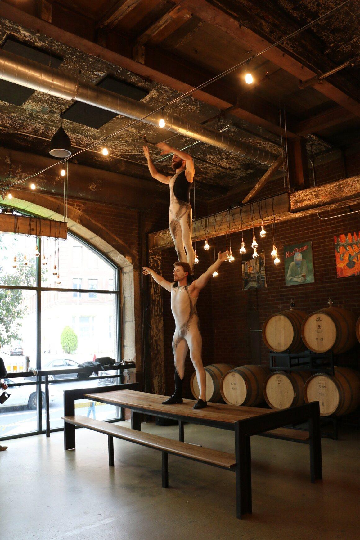 Acrobats Ara and Oli of Cirque-tacular perform feats.
