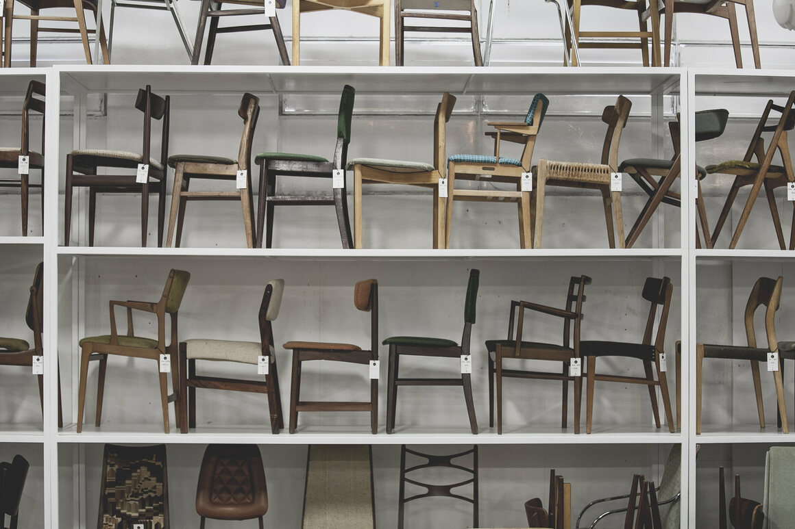 MIDCENTURYLA's wall of chairs.