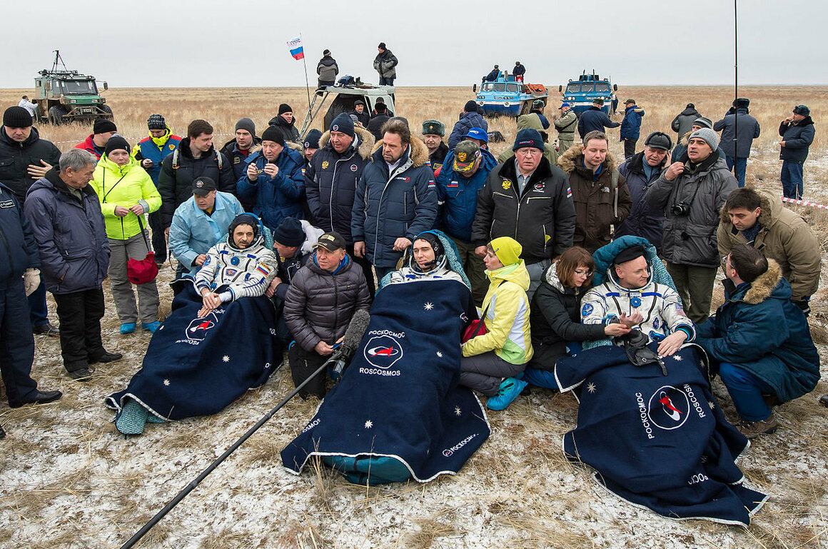 From left, Kornienko, cosmonaut Sergey Volkov, and Kelly rest in chairs outside the Soyuz TMA-18M spacecraft just minutes after landing near the town of Zhezkazgan, Kazakhstan, March 2, 2016.