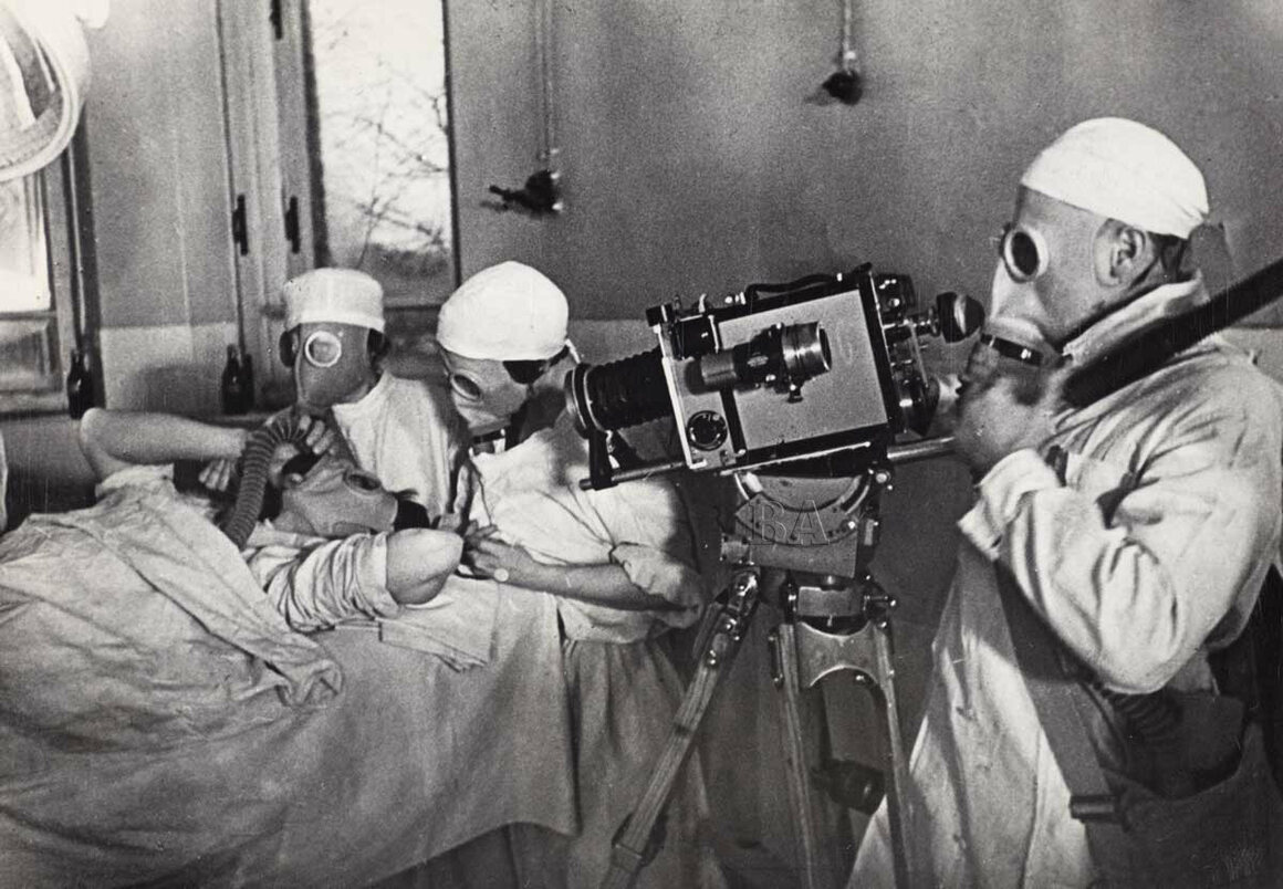 Gas masks in an operating room at Botkin Hospital, Moscow, 1936.
