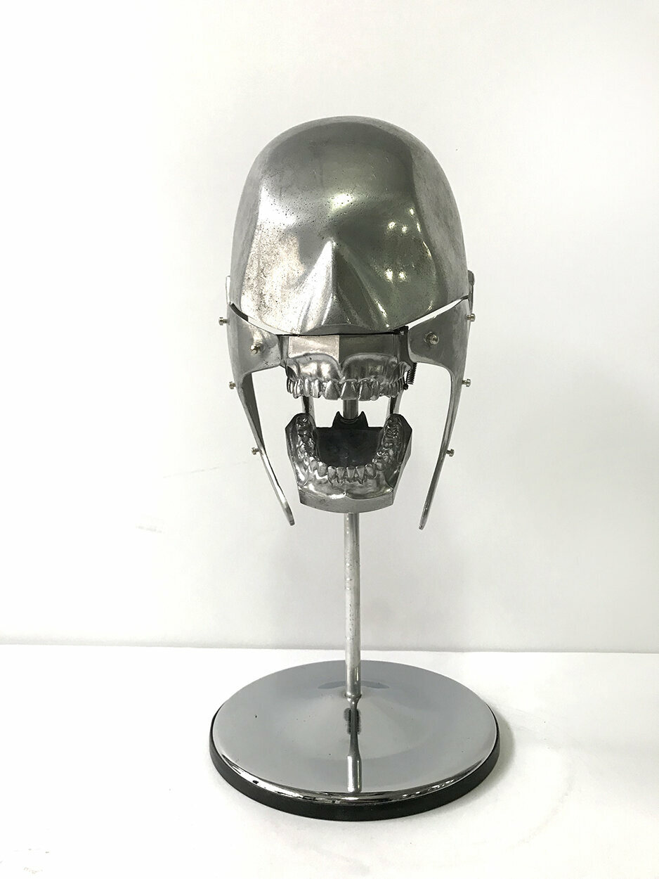 An aluminum dental mannequin from the 1930s, made by Columbia Dental.