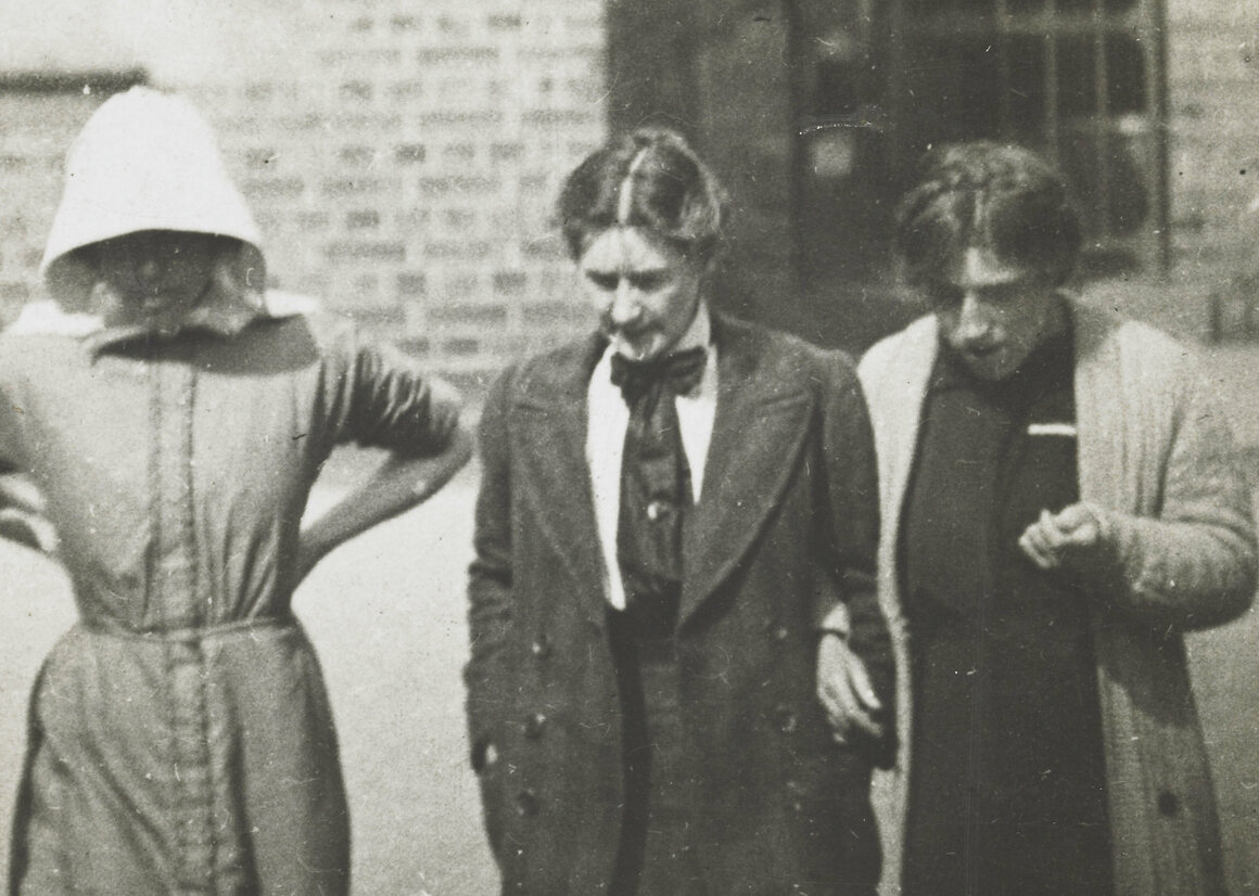 An undercover photographer working for the Home Office captured Suffragettes in the yard of Holloway Prison.