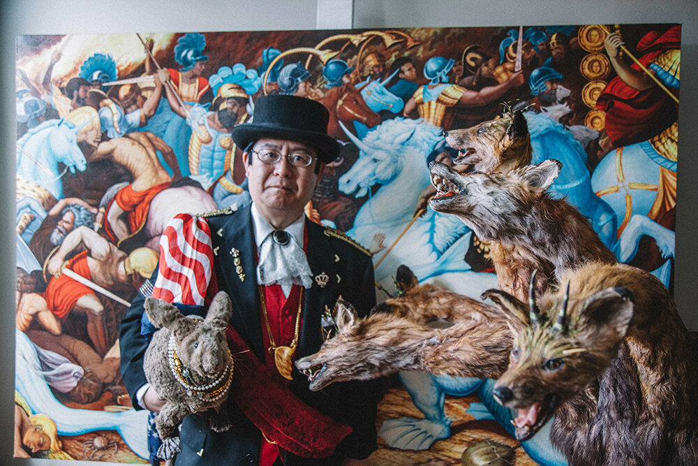 "Takeshi Yamada with Seara, the sea rabbit, and his five-headed ""Monster from Hell."""