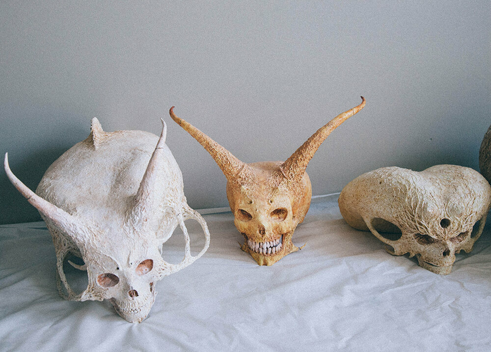 Three of Yamada's space alien skulls.