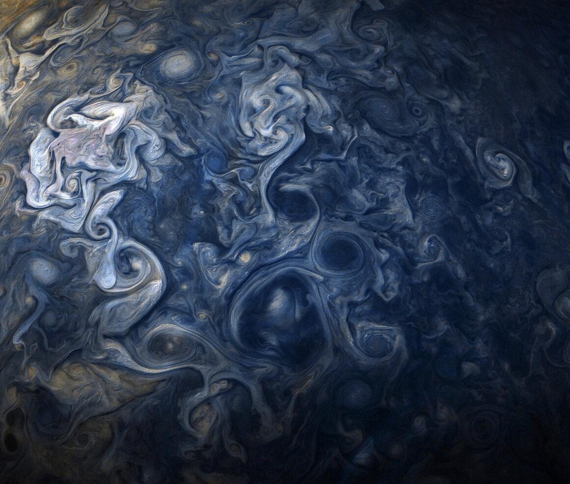 A color-enhanced image Jupiter's cloud systems, shot by <em>Juno</em>, October.