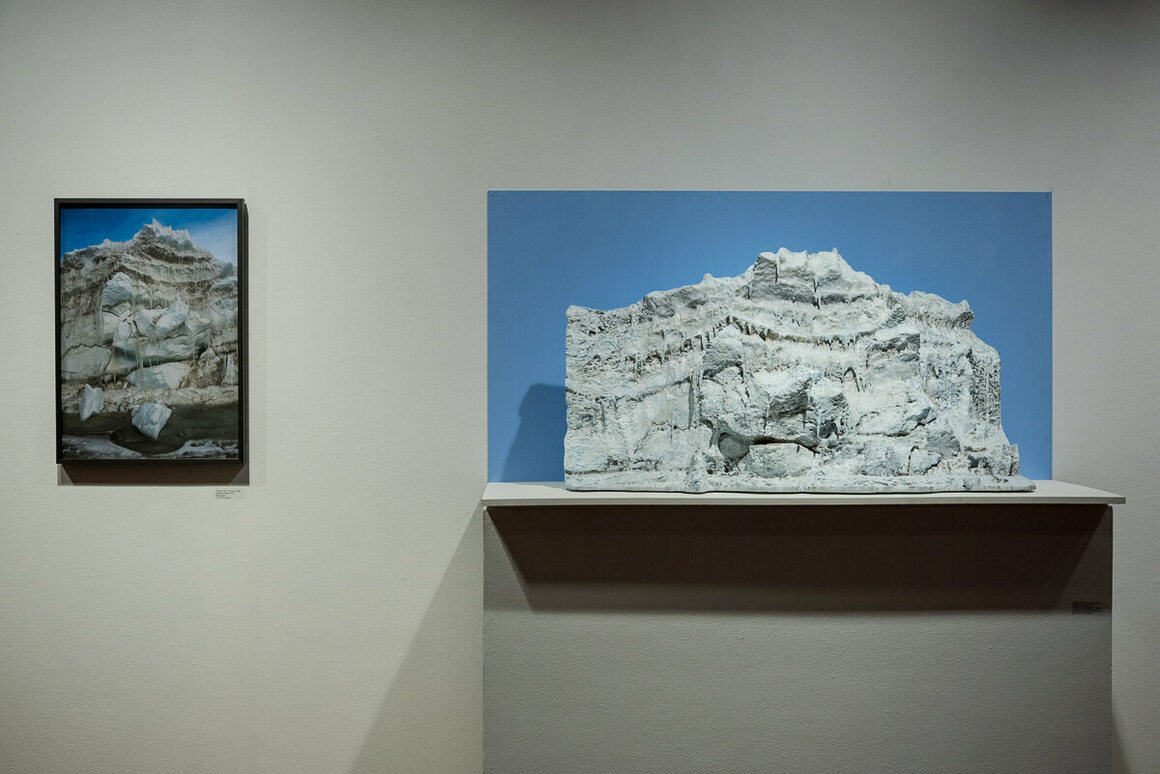 """A three-foot-long sculpture of a pressure ridge near the Double Curtain Glacier, next to a photograph of its real-life equivalent. Glazer calls this the """"Giant's Face"""" due to its various protrusions."""