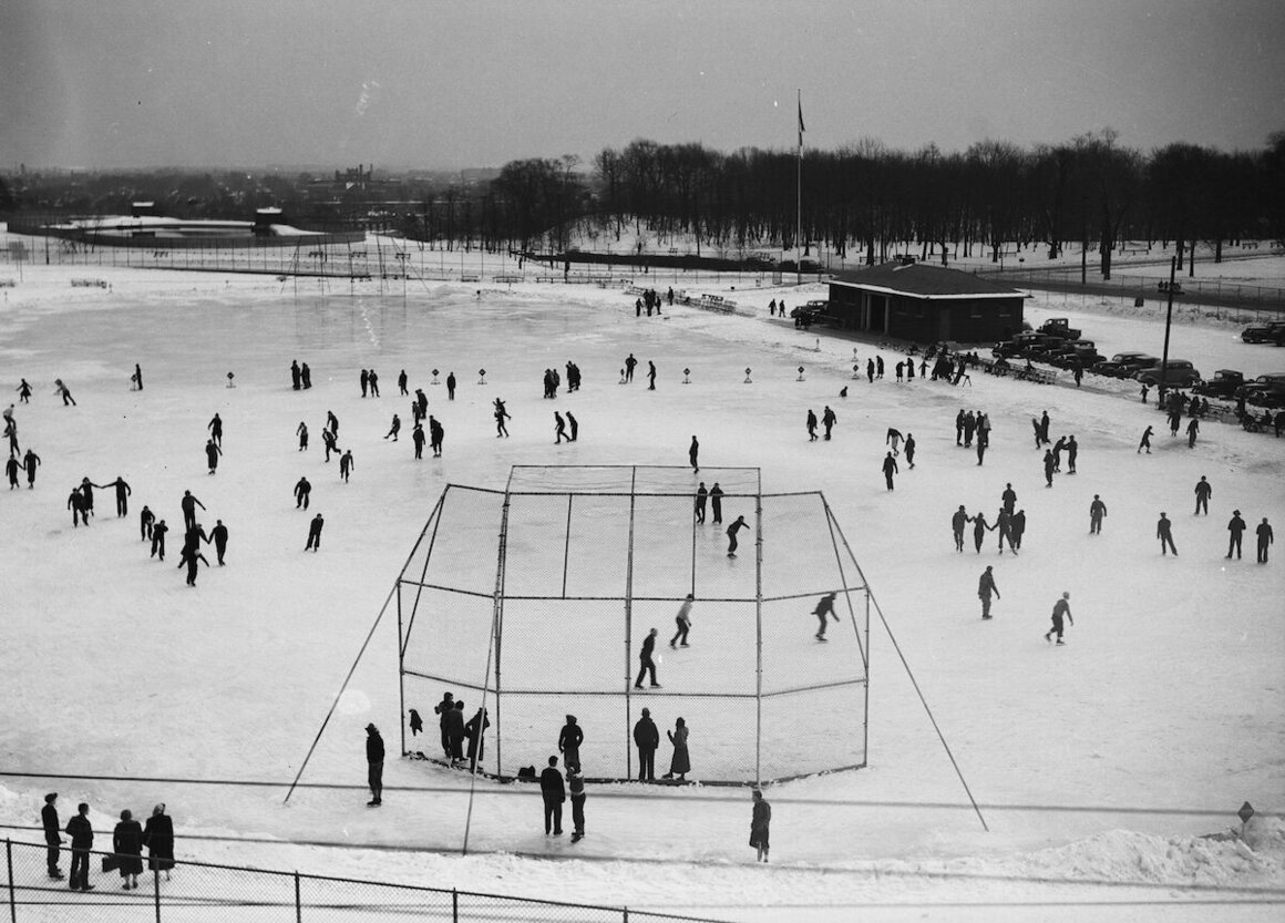 Flooded ballpark with skaters, Central Park, 1938.