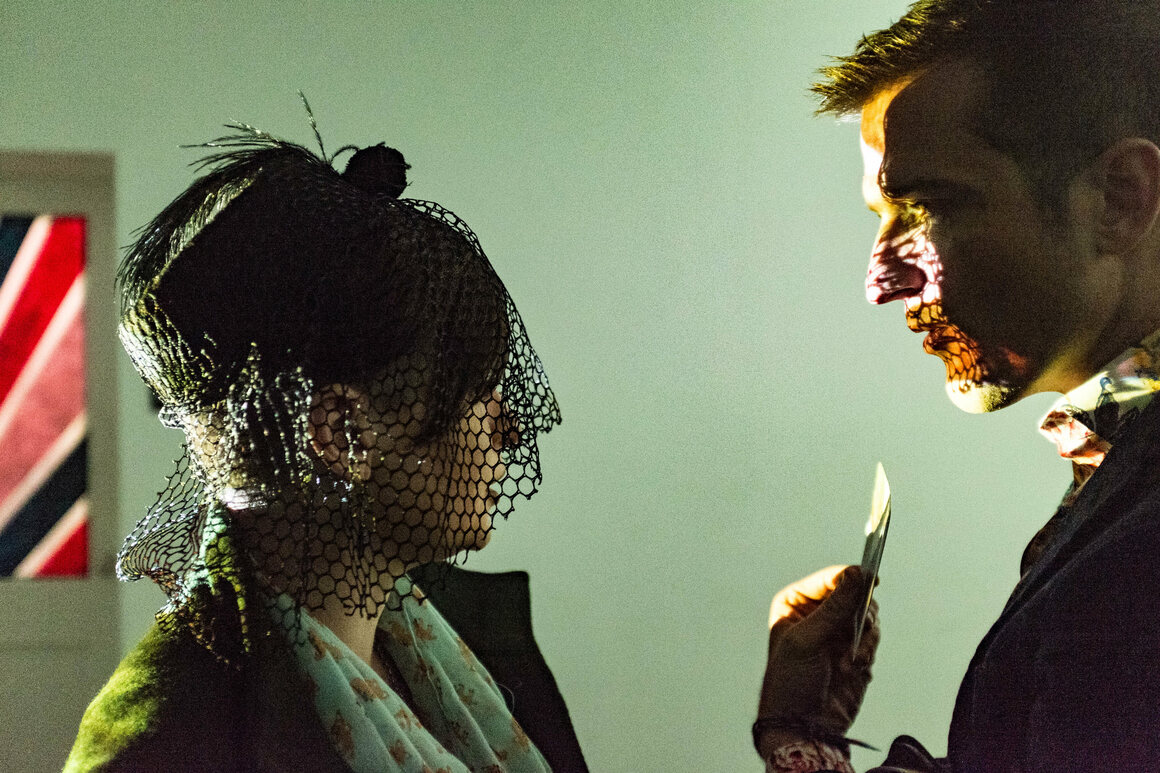 The evening was moody and magical as guests entertained each other with card tricks.