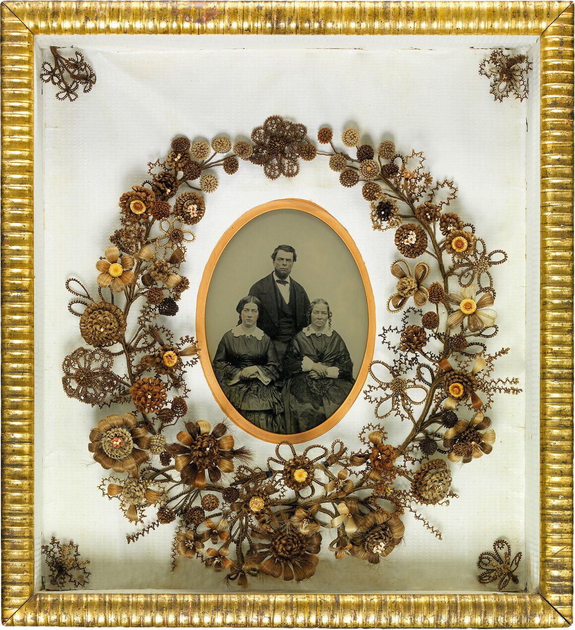 Wreath surrounding an ambrotype, made from wood, glass, ambrotype, wire, straw flowers, paper, and human hair using gimp work, mid-19th century.