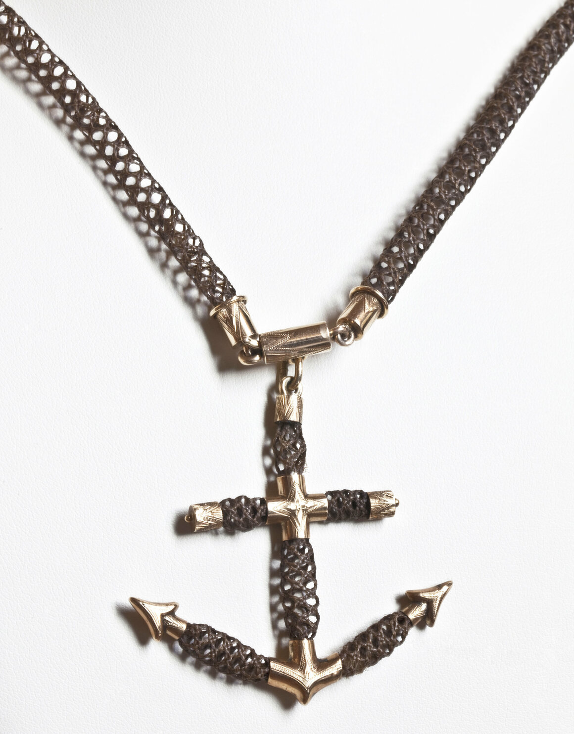 Necklace with anchor pendant, made from gold and human hair using table work, mid-to-late 19th century.