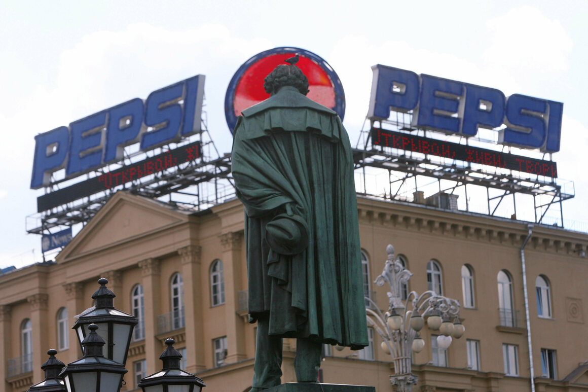 A statue of Pushkin watching over the Pepsi signs.