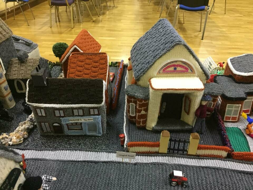 The building on the right is the town's Orange Hall, in which the model village is displayed.