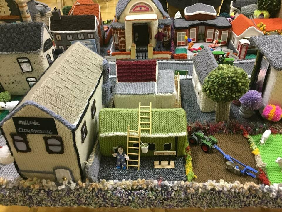 The village's houses and tennis hall alike have been rendered in wool.