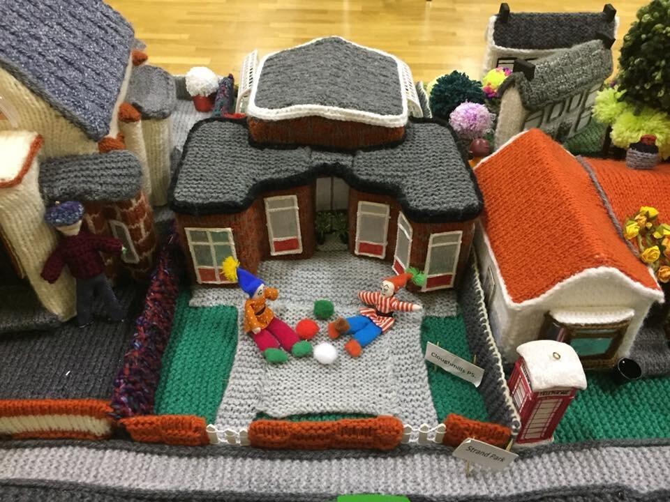 Woolen people complete the idyllic village scene.