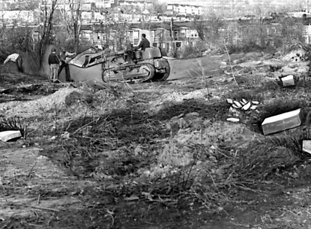 Bulldozers demolish Laurel Hill Cemetery, November 1958.