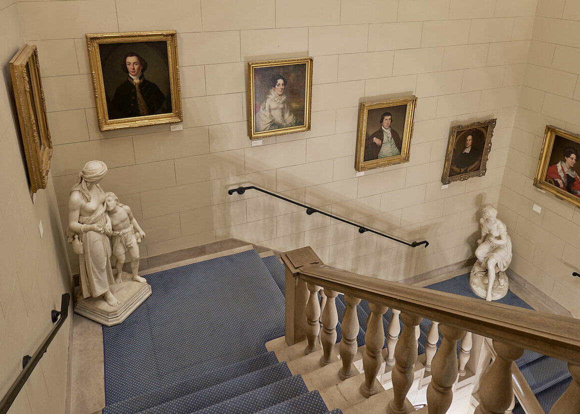Portraits of the Goodhue family line the Library's grand staircase.